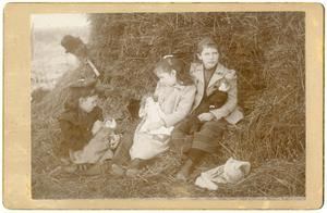 Primary view of object titled '[Children Seated By a Bale of Hay]'.