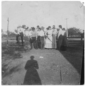 Primary view of object titled '[Men and Women Gathered at a Fence]'.