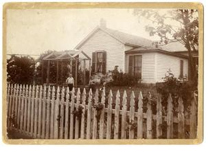 Primary view of object titled '[A White House with Children in the Yard]'.