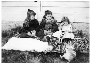 Primary view of object titled '[Four Children on a Blanket with Cats]'.