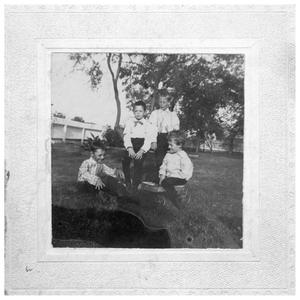 Primary view of object titled '[Four Boys in a Yard]'.