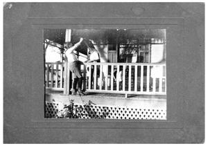 [John A. Matthews, Jr. and Dogs on a Porch]