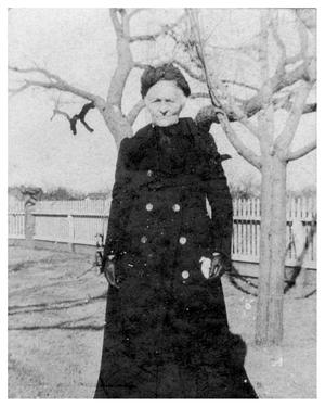 Primary view of object titled '[Elderly Woman in a Long Black Peacoat]'.