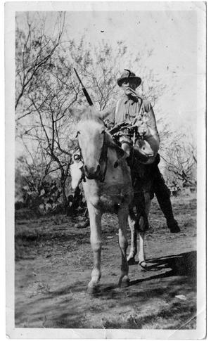 [Man on Horseback Holding a Long Gun]
