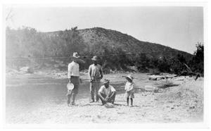 [Three Men and a Child at Burkett Bend]