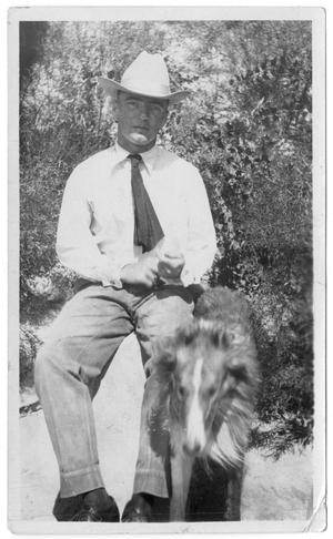 Primary view of object titled '[Watt Matthews Seated Outside with a Dog]'.