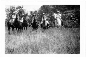 Primary view of object titled '[Five People on Horseback in a Field]'.