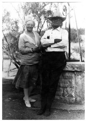 Primary view of object titled '[Photograph of John and Sallie Matthews by a Well]'.