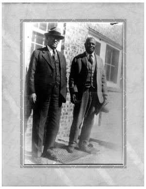 Primary view of object titled '[Two Men in Front of a House]'.