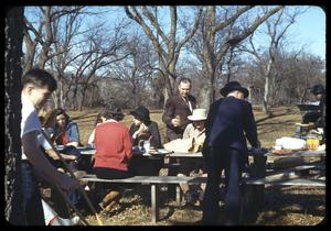 Primary view of object titled '[People at an Outdoor Picnic Table]'.