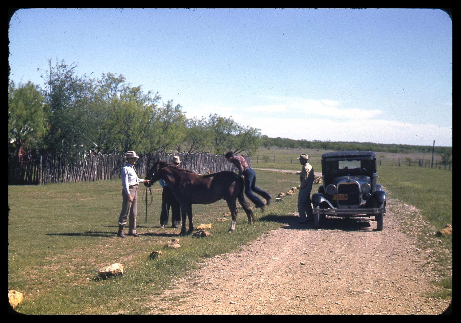 [People with a Horse and Car at a Dirt Road]                                                                                                      [Sequence #]: 1 of 1