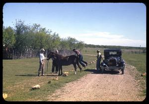 Primary view of object titled '[People with a Horse and Car at a Dirt Road]'.