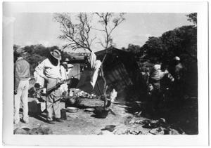 Primary view of object titled '[Men at Camp]'.