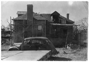 Primary view of object titled '[N. L. Bartholomew House Undergoing Renovation]'.