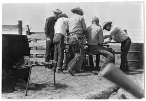 Primary view of object titled '[Cowboys Around a Cattle Branding Station]'.