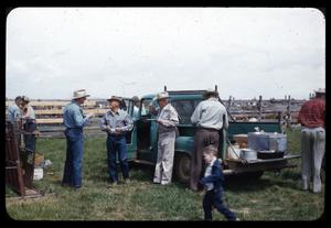 Primary view of object titled '[Cowboys and a Child Around a Truck]'.