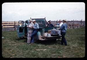 Primary view of object titled '[Cowboys Around a Truck]'.