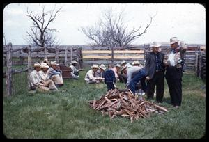 Primary view of object titled '[Cowboys Having a Meal in a Fenced Area]'.