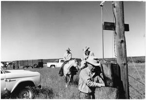 Primary view of object titled '[Watt Matthews on the Phone at the Airstrip near White Flat]'.