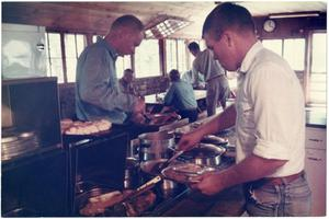 Primary view of object titled '[Cowboys Eating Lunch at the Matthews Ranch Cookshack]'.
