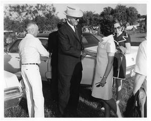 Primary view of object titled '[Lyndon B. Johnson Shaking a Woman's Hand]'.