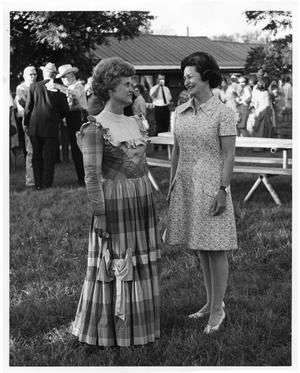 Primary view of object titled '[Lady Bird Johnson with a Costumed Woman]'.