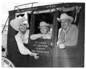 Primary view of object titled '[Carol Channing, Watt Matthews, and Cactus Pryor in a Butterfield Stagecoach]'.
