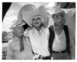 [Carol Channing between Watt Matthews and Joe B. Matthews]