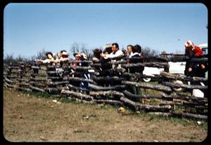 Primary view of object titled '[People Leaning on a Fence]'.