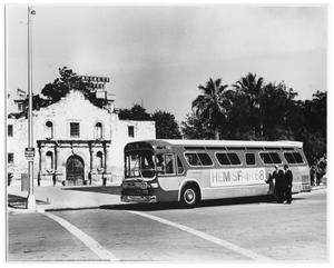 Primary view of object titled 'Tour bus in front of the Alamo'.
