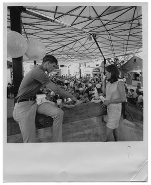 Primary view of object titled 'Young couple eating at HemisFair '68'.