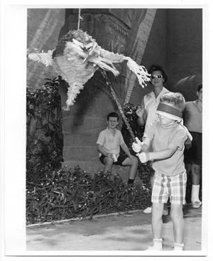 Primary view of object titled 'Young boy hitting a pinata at HemisFair '68'.