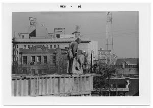 Primary view of object titled 'Two men on a concrete platform'.