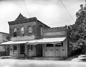 Primary view of object titled '[Peter Ingenhuett Building and Kash/Karry Grocery Store, (Northwest oblique)]'.