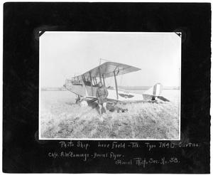 Primary view of object titled '[Aerial Flyer A. W. Comings in Front of Biplane]'.