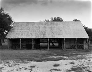 Primary view of object titled '[Badenthal, (Southwest elevation of Cypress Barn Enclosing Log Building.)]'.