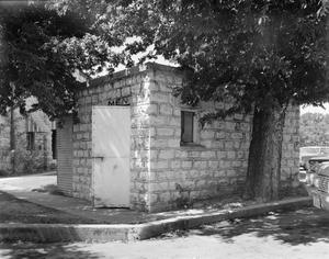 Primary view of object titled '[Somervell County Courthouse, (Northeast oblique, 1 of 2 outbuildings)]'.