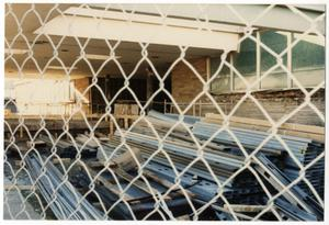 Primary view of object titled '[Dallas Love Field Airport : Fenced in Construction Materials]'.
