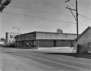 Primary view of object titled '[Western Auto, Pena and Sons Building]'.