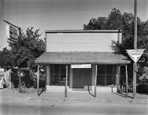 Primary view of object titled '[Pioneer Store, (East facade)]'.