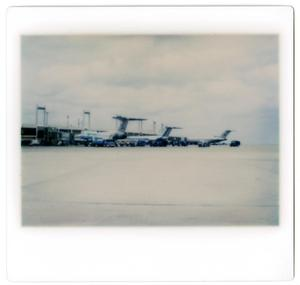 Primary view of object titled '[Dallas/Fort Worth Airport: Several Airplanes Attached to Jetways]'.