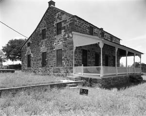 Primary view of object titled '[1 1/2 Story Rock House, (Southeast oblique)]'.