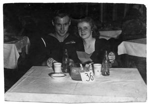 Primary view of object titled '[James E. Sutherlin and Arlene Goodwin Together at a Table]'.