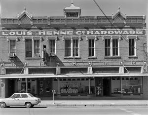 Primary view of object titled '[Henne Hardware Building, (East elevation and store front)]'.