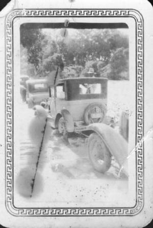 Primary view of object titled '[Cars attempting to travel through flooded roads]'.