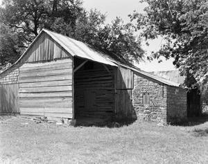 Primary view of object titled '[Kusenburger Homestead, (Northeast oblique of outbuilding)]'.
