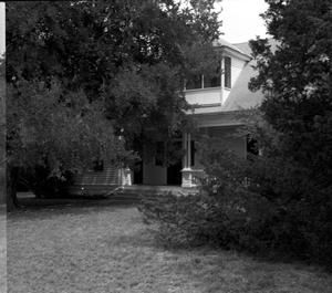 Primary view of object titled '[C.P Johnson Home, (Partial West elevation through trees)]'.