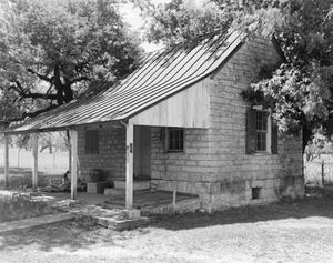Primary view of object titled '[Kusenburger Homestead, (Northeast oblique of smokehouse)]'.