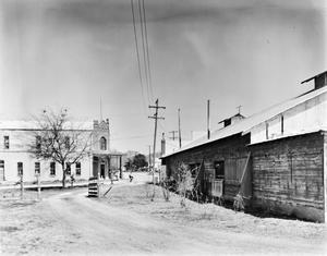 Primary view of object titled '[Gruene Hall, (Side view of Gruene Hall (on right))]'.