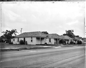 Primary view of object titled '[Row of Shotgun Houses, (Northwest oblique)]'.